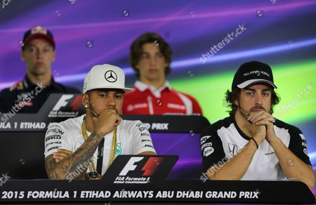 Lewis Hamilton, Fernando Alonso, Daniil Kvyat, Roberto Merhi Bottom row left to right, Mercedes AMG Petronas F1 Team's British driver Lewis Hamilton, McLaren Honda's Spanish driver Fernando Alonso, and top row left to right, Infiniti Red Bull Racing's Russian driver Daniil Kvyat and Manor F1 Team's Spanish driver Roberto Merhi, listen during a press conference at the Yas Marina racetrack in Abu Dhabi, United Arab Emirates, . The Emirates Formula One Grand Prix will take place on Sunday