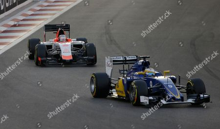 Sauber driver Marcus Ericsson of Sweden leads Manor driver Will Stevens of Britain during the Emirates Formula One Grand Prix at the Yas Marina racetrack in Abu Dhabi, United Arab Emirates