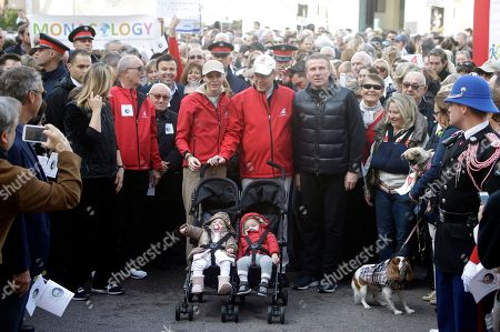 Prince Albert II of Monaco, center, with his wife Princess Charlene and their twins, Prince Jacques, right, and Princess Gabriella,and Sergey Bubka, former Ukrainian pole vaulter and member of the International Association of Athletics Federations (IAAF), right, take part to the World Climate March in Monaco, . This march takes place ahead of the Conference of Parties to the United Nations Framework Convention on Climate Change (COP 21), in Paris, France