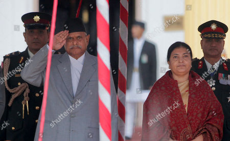 Stock Image of Bidhya Devi Bhandari, Ram Baran Yadav Nepal's outgoing President Ram Baran Yadav, salutes as newly elected president Bidhya Devi Bhandari,right, prepares to take oath in Kathmandu, Nepal, . Nepalese lawmakers elected a longtime women's rights campaigner to become the country's first female president Wednesday, as the Himalayan nation pushes for more gender equality in politics and work life