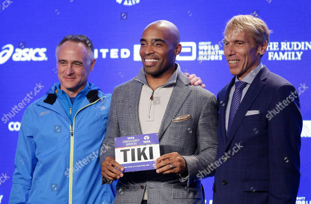 Tiki Barber, Peter Ciaccia, Michael Capiraso Former NFL player Tiki Barber, center, poses for a picture with Peter Ciaccia, New York City Marathon race director, right, and Michael Capiraso, New York Road Runners CEO, during a news conference in New York, . Barber is planning to take part in the marathon on Sunday, Nov. 1, 2015