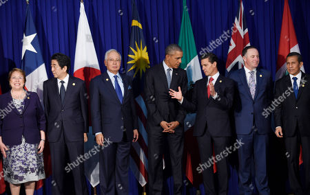 Barack Obama, Michelle Bachelet, Shinzo Abe, Najib Razak, Enrique Pena Nieto, John Key, Ollanta Humala Tasso President Barack Obama talks with Mexico's President Enrique Pena Nieto as other leaders of the Trans-Pacific Partnership countries stand for a group photo in Manila, Philippines, ahead of the start of the Asia-Pacific Economic Cooperation (APEC) summit. From left, Chile's President Michelle Bachelet, Japan's Prime Minister Shinzo Abe, Malaysia's Prime Minister Najib Razak, President Obama, Mexico's President Enrique Pena Nieto, New Zealand's Prime Minister John Key, and Peru's President Ollanta Humala Tasso