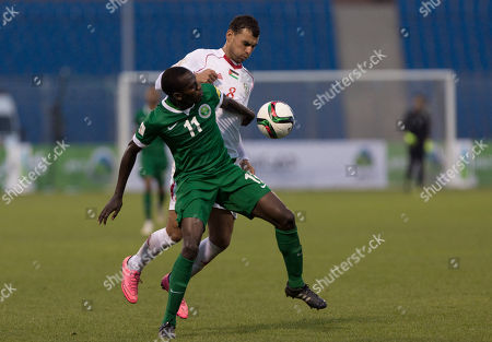 Stock Picture of Sameh Maraaba, Abdulmalek al Khaibri Saudi Arabia's Abdulmalek al Khaibri, left blocks Palestine's Sameh Maraaba during the 2018 Russia World Cup qualifying soccer match in Amman, Jordan, . The match ended with a 0-0 draw