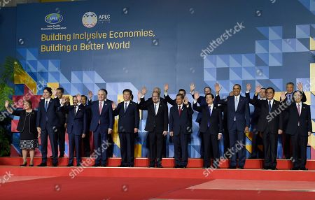 Barack Obama President Barack Obama, third right in front, poses for a family photo with other leaders at the Asia-Pacific Economic Cooperation summit in Manila, Philippines, . Leaders in front row are, from left, Chile's President Michelle Bachelet, Canadian Prime Minister Justin Trudeau, Brunei's Sultan Hassanal Bolkiah, Australia's Prime Minister Malcolm Turnbull, Chinese President Xi Jinping, Philippines President Benigno Aquino III, Peru's President Ollanta Humala Tasso, Vietnam's President Truong Tan Sang, Obama, Thai Prime Minister Prayuth Chan-ocha and Taiwan's envoy Vincent Siew