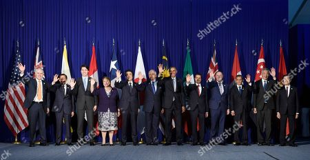 Barack Obama, Malcolm Turnbull, Hassanal Bolkiah, Justin Trudeau, Michelle Bachelet, Shinzo Abe, Najib Razak, Enrique Pena Nieto, John Key, Ollanta Humala Tasso, Lee Hsien Loong, Truong Tan Sang President Barack Obama, center right, and other leaders of the Trans-Pacific Partnership countries pose for a photo in Manila, Philippines, ahead of the start of the Asia-Pacific Economic Cooperation summit. The leaders are, from left, Australia's Prime Minister Malcolm Turnbull, Brunei's Sultan Hassanal Bolkiah, Canada's Prime Minister Justin Trudeau, Chile's President Michelle Bachelet, Japan's Prime Minister Shinzo Abe, Malaysia's Prime Minister Najib Razak, Obama, Mexico's President Enrique Pena Nieto, New Zealand's Prime Minister John Key, Peru's President Ollanta Humala Tasso, Singapore's Prime Minister Lee Hsien Loong, and Vietnam's President Truong Tan Sang