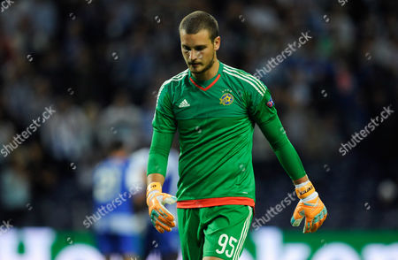 Maccabi's goalkeeper Predrag Rajkovic reacts after Porto scored their second goal during the Champions League group G soccer match between FC Porto and Maccabi Tel-Aviv FC at the Dragao stadium in Porto, Portugal