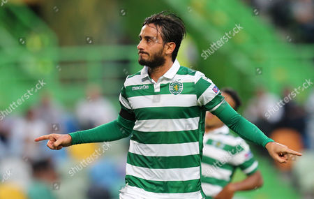 Sporting's Alberto Aquilani celebrates after scoring the opening goal during the Europa League group H soccer match between Sporting CP and Skenderbeu at the Alvalade stadium in Lisbon