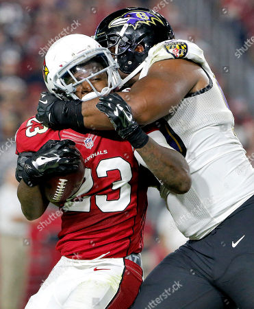Chris Johnson, Chris Canty Arizona Cardinals running back Chris Johnson (23) is hit by Baltimore Ravens defensive end Chris Canty (99) during the second half of an NFL football game, in Glendale, Ariz