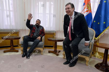 U.S actor and producer Steven Seagal, left, waves to reporters during a meeting with Serbian Prime Minister Aleksandar Vucic, in Belgrade, Serbia, . The veteran American actor and producer was on Tuesday offered to train Serbian special police forces in Aikido, a Japanese martial art, which he has been famous for in a series of his blockbuster movies