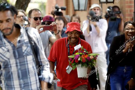A delivery man delivers flowers to the home of Arnold Pistorius, the uncle of Oscar, in Pretoria, South Africa, . Oscar Pistorius' release from prison to serve the remainder of a five-year manslaughter sentence under house arrest was the latest chapter in the story of a once-inspiring double-amputee runner who made history at the Olympics, and then killed his girlfriend