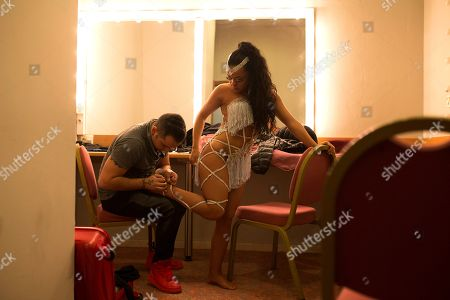 Dancers Alba Ibanez, right, and Luis Chavez, both from Spain, dress up backstage before taking part in the World Salsa Master dance competition in Madrid. Ten dance couples of from different countries around the world performed in front of an audience of around 2,000 people