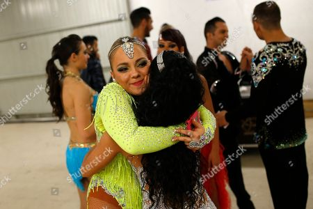 Spanish dancer Maria Garrido, left, congrats Alba Ibanez, also from Spain, after Ibanez won with her partner Luis Chavez, rear second right, the World Salsa Master dance competition in Madrid. Participants _ who wore bright, colorful outfits _ came from the United States, Italy, Spain, Portugal, Mexico, Chile, Uruguay, Czech Republic and Venezuela