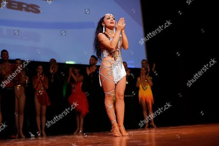 Spanish dancer Alba Ibanez reacts after winning with her partner Luis Chavez the World Salsa Master dance competition in Madrid