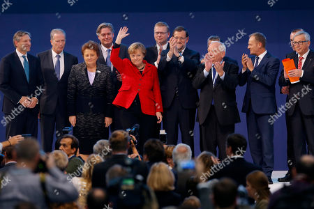 Jean-Claude Juncker, Joseph Daul, Angela Merkel, Mariano Rajoy, Antonio Lopez-Isturiz, Reinhold Mitterlehner, Enda Kenny, Donald Tusk, Pavel Belobradek, Laimdota Straujuma Austrian Vice Chancellor Reinhold Mitterlehner, second left, Irish Prime Minister Enda Kenny, left, European Council President Donald Tusk, second right, Latvia's Prime Minister Laimdota Straujuma, third left, European People's Party General Secretary Antonio Lopez-Isturiz, fourth left, Czech Republic's Deputy Prime Minister Pavel Belobradek, fifth right, German Chancellor Angela Merkel, fifth left, Spain's Prime Minister Mariano Rajoy, forth right, European People's Party President Joseph Daul, third right, and European Commission President Jean-Claude Juncker, right, pose for a family photograph at the end of the European People's Party congress in Madrid, Spain, . Various European conservative leaders and former leaders are participating in the two-day event
