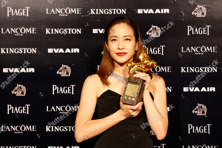 "Karena Lam Taiwanese actress Karena Lam holds her award for Best Leading Actress at the 52nd Golden Horse Awards in Taipei, Taiwan, . Lam won for the film ""Zinnia Flower"" at this year's Golden Horse Awards, one of the Chinese-language film industry's biggest annual events"