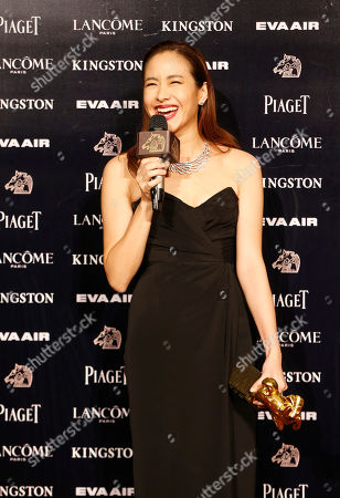 "Karena Lam Taiwanese actress Karena Lam comments to media as she holds her award for Best Leading Actress at the 52nd Golden Horse Awards in Taipei, Taiwan, . Lam won for the film ""Zinnia Flower"" at this year's Golden Horse Awards, one of the Chinese-language film industry's biggest annual events"