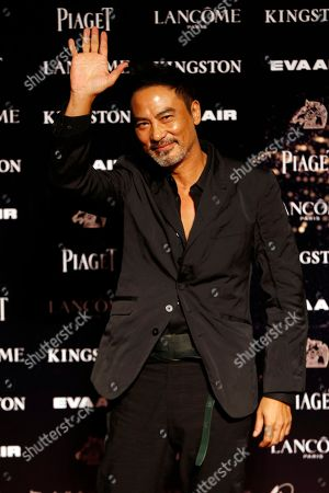 Simon Yam Hong Kong actor Simon Yam poses on the red carpet at the 52nd Golden Horse Awards in Taipei, Taiwan, . Wang is a guest at this year's Golden Horse Awards, one of the Chinese-language film industry's biggest annual events