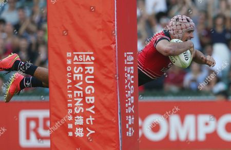 Stock Image of Christopher Russell Maize Hong Kong's Christopher Russell Maize scores a try during their semifinal match against South Korea of Asia Rugby Sevens man's qualifying matches for the 2016 Rio Olympics, in Hong Kong