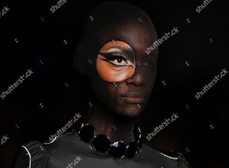Stock Picture of A model wears a creation from the Alexandre Herchcovitch winter collection during the Sao Paulo Fashion Week in Sao Paulo, Brazil