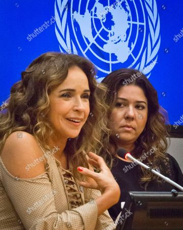 """Stock Picture of Daniela Mercury, Malu Verçosa Brazilian activist and singer Daniela Mercury, left, a representative for U.N. Free and Equal (UNFE), and her wife Malu Vercosa Mercury, right, hold a press conference on at U.N. headquarters. UNFE, a U.N. global education program for lesbian, gay, bisexual and transgender (LGBT) equality, will use the video """"Celebrate Love,"""" featuring their wedding, as part of its LGBT equality campaign in Brazil"""