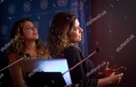 """Daniela Mercury, Malu Verçosa Brazilian activist and singer Daniela Mercury, left, a representative for U.N. Free and Equal (UNFE), and her wife Malu Vercosa Mercury, right, view their wedding video """"Celebrate Love,"""" during a press conference on at U.N. headquarters. UNFE, a U.N. global education program for lesbian, gay, bisexual and transgender (LGBT) equality, will use the video in Brazil as part of its LGBT equality campaign"""