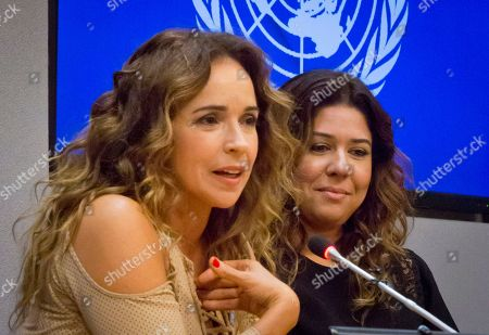 """Daniela Mercury, Malu Verçosa Brazilian activist and singer Daniela Mercury, left, a representative for U.N. Free and Equal (UNFE), and her wife Malu Vercosa Mercury, right, hold a press conference on at U.N. headquarters. UNFE, a U.N. global education program for lesbian, gay, bisexual and transgender (LGBT) equality, will use the video """"Celebrate Love,"""" featuring their wedding, as part of its LGBT equality campaign in Brazil"""