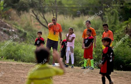 Stock Photo of Carlos Leon gives instructions to his players during a soccer game in Santa Teresa, Venezuela. Leon left the ruling party after writing a rap song protesting the difficult situation facing everyday Venezuelans. He says he was shunned by fellow party members after writing the song