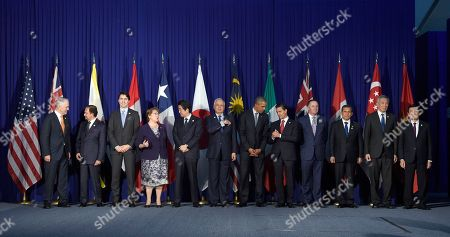 Barack Obama, Malcolm Turnbull, Hassanal Bolkiah, Justin Trudeau, Michelle Bachelet, Shinzo Abe, Najib Razak, Enrique Pena Nieto, John Key, Ollanta Humala Tasso, Tony Tan Keng Yam, Truong Tan Sang President Barack Obama, center right, and other leaders of the Trans-Pacific Partnership countries pose for a photo in Manila, Philippines, ahead of the start of the Asia-Pacific Economic Cooperation summit. The leaders are, from left, Australia's Prime Minister Malcolm Turnbull, Brunei's Sultan Hassanal Bolkiah, Canada's Prime Minister Justin Trudeau, Chile's President Michelle Bachelet, Japan's Prime Minister Shinzo Abe, Malaysia's Prime Minister Najib Razak, Obama, Mexico's President Enrique Pena Nieto, New Zealand's Prime Minister John Key, Peru's President Ollanta Humala Tasso, Singapore's Prime Minister Lee Hsien Loong, and Vietnam's President Truong Tan Sang