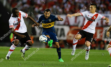 Carlos Tevez Matias Kranevitter, right, and Eder Alvarez Balanta, left, of River Plate fight for the ball with Carlos Tevez of Boca Juniors during a local tournament soccer match in Buenos Aires, Argentina