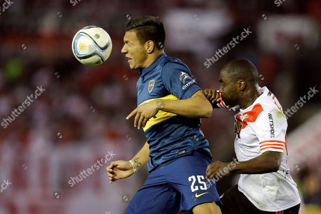 Andres Chavez Andres Chavez of Boca Juniors, left, heads the ball against Eder Alvarez Balanta of River Plate during an Argentine soccer league match in Buenos Aires, Argentina
