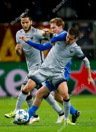 Stock Image of Roma's Miralem Pjanic, right, and BATE's Alexander Hleb vie for the ball as Roma's Kostas Manolas, left, looks at them, during the Champions League group E soccer match between Bate Borisov and Roma, in Borisov, Belarus