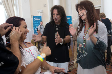 Alice Cooper, Sheryl Goddard American musician Alice Cooper, center, and his wife Sheryl Goddard, right, smile while a woman receives a hearing device in Rio de Janeiro, Brazil, . Starkey Hearing Foundation and the Hollywood Vampires band are joining forces in Rio de Janeiro to provide more than 200 children and adults in need the gift of hearing in advance of the supergroup's performance on the main stage at the Brazilian edition of Rock in Rio festival