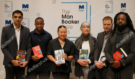 Authors nominated for the 2015 Man Booker Prize; from left, Sunjeev Sahota, Chigozie Obioma, Hanya Yanagihara, Anne Tyler, Tom McCarthy and Marlon James pose with their books on stage at the Royal Festival Hall in London, . The six authors are short-listed for the 2015 Man Booker Prize for Fiction, and the winner will be announced Tuesday Oct. 13