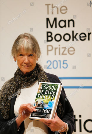 Author Anne Tyler poses with her book 'A Spool of Blue Thread' on stage at the Royal Festival Hall in London, . Tyler is one of six short-listed authors of the 2015 Man Booker Prize for Fiction, and the winner will be announced Tuesday Oct. 13