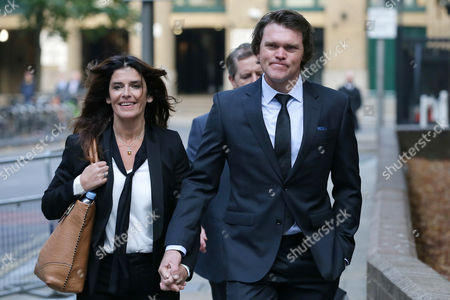 Former New Zealand cricketer Lou Vincent arrives at Southwark Crown Court, with his partner Susie Markham, where he is a witness in the trial of former New Zealand cricketer Chris Cairns, in London, . Cairns faces charges of perjury and perverting the course of justice in relation to a libel case he brought against Indian Premier League founder Lalit Modi