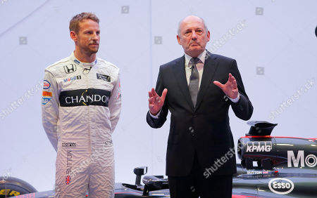 McLaren F1 car brand CEO Ron Dennis, right, gestures with Britain's McLaren F1 driver Jenson Button at left, during a presentation in Woking, England, . McLaren announced a new sponsorship deal with champagne brand Chandon