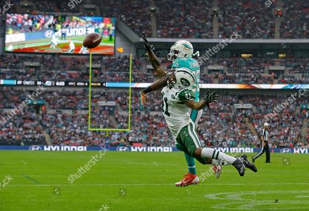 New York Jets' Buster Skrine blocks a pass intended for Miami Dolphins' Greg Jennings during the NFL football game between the New York Jets and the Miami Dolphins and at Wembley stadium in London