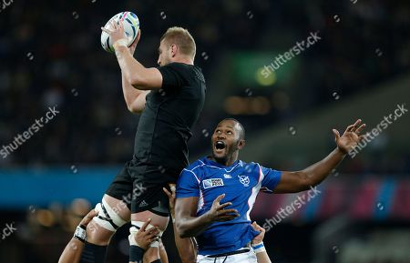 New Zealand's Luke Romano, left, wins the ball in a line out against Namibia's Tijuee Uanivi during the Rugby World Cup Pool C match between New Zealand and Namibia at the Olympic Stadium, London