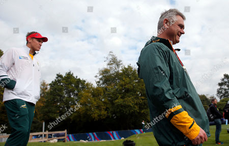 Stock Image of South Africa head coach Heyneke Meyer, right, and Jean de Villiers arrive for a training session at Pennyhill Park, in Bagshot, outside London, . South Africa will play Wales during their Rugby World Cup quarterfinal match on Saturday, Oct. 17