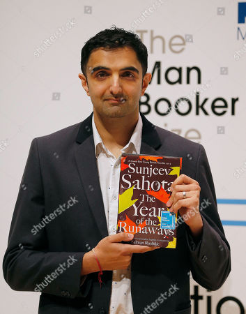 Author Sunjeev Sahota poses with his book 'The Year of The Runaways' on stage at the Royal Festival Hall in London. Sahota attended the 2015 Guadalajara International Book Fair in December where the U.K. was the guest of honor. Sahota attended the fair as part of the British delegation