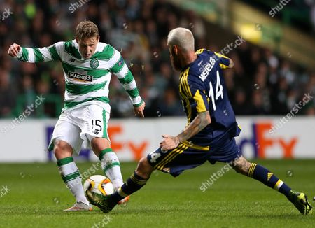 Celtic's Kris Commons, left, vies for the ball with Fenerbahce's Raul Meireles, right, during the Europa League Group A soccer match between Celtic and Fenerbahce at Celtic Park, Glasgow, Scotland