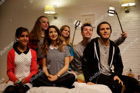 "Youngsters pose for photographers at the launch of waxworks of internet video-sharing website YouTube ""vlog"", video blog, British celebrities Zoe Sugg, third left, and Alfie Deyes, right, at Madame Tussauds waxworks in London, . The couple are very popular with youngsters, with their YouTube channels attracting a combined number of over 13 million subscribers"