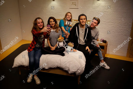 "Youngsters pose for photographers at the launch of waxworks of internet video-sharing website YouTube ""vlog"", video blog, British celebrities Zoe Sugg, second left, and Alfie Deyes, second right, at Madame Tussauds waxworks in London, . The couple are very popular with youngsters, with their YouTube channels attracting a combined number of over 13 million subscribers"