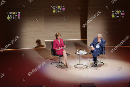 First Minister of Scotland Nicola Sturgeon speaks with Harold Evans, right, during the Women in the World Summit at Cadogan Hall in London