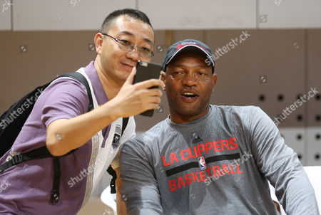 "Glenn ""Doc"" Rivers Los Angeles Clippers head coach Glenn ""Doc"" Rivers poses with his fan during a training session in Shenzhen, south China's Guangdong province, . The Charlotte Hornets will play with the Clippers on Oct. 11 in Shenzhen"