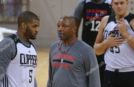 "Glenn ""Doc"" Rivers Los Angeles Clippers head coach Glenn ""Doc"" Rivers blows a whistle during a training session in Shenzhen, south China's Guangdong province, . The Charlotte Hornets will play with the Clippers on Oct. 11 in Shenzhen"