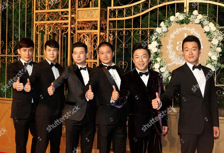 Tong Dawei, Huang Bo, Wu Jing Chinese actors Tong Dawei, at right, Huang Bo, second from right, and Wu Jing, third from right, pose for a photo at the wedding of Huang Xiaoming and Angelababy in Shanghai, China