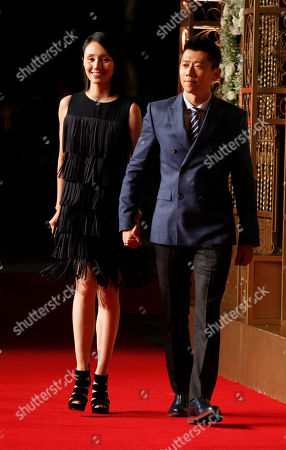 Yuan Quan, Xia Yu Hinese actress Yuan Quan and Chinese actor Xia Yu walk on the red carpet at a wedding for Chinese actor Huang Xiaoming and Chinese actress Angelababy in Shanghai, China