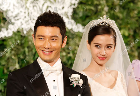 Huang Xiaoming, Angelababy Chinese actor Huang Xiaoming and Chinese actress Angelababy listen to a speaker at their wedding in Shanghai, China