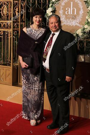 Hong Jinbao, Gao Lihong Hong Kong actor Hong Jinbao, right, and his wife Gao Lihong pose for a photo at a wedding for Chinese actor Huang Xiaoming and Chinese actress Angelababy in Shanghai, China